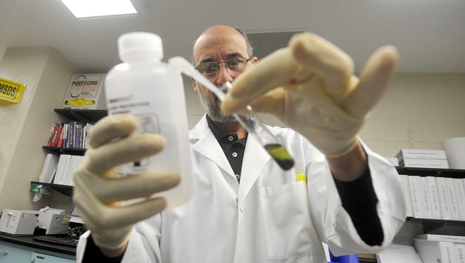 Tony Tambasco, Director of the Mansfield Police Forensic Science Laboratory, tests a substance believed to be a synthetic cannabinoid.
