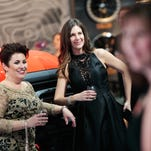 Stylish attire mingles with metal at Detroit auto show charity gala