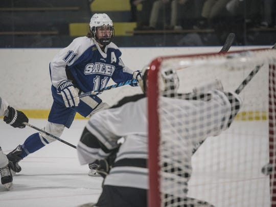 Salem's Marty Mills scores the first goal as the puck sails past Plymouth goalie Brendan Olepa.