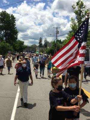 Police Chief Dana Lajoie (left) joined about 300 walkers in South Berwick Sunday for a Sister City Solidarity Walk from town hall and down a closed Main Street and Portland Avenue.