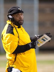 Central head football coach Tyrran Scroggins looks at his team on the sidelines in the KHSAA Class 3-A state semi-final.25 November 2016