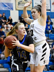 Kennard-Dale's Chandler Swanson, left, works to get