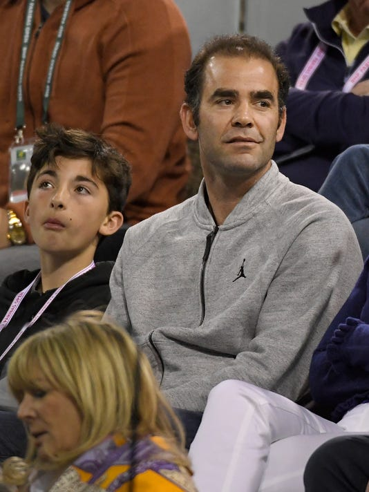 Former tennis player Pete Sampras watches a quarterfinal between Roger Federer, of Switzerland, and Chung Hyeon, of South Korea, at the BNP Paribas Open tennis tournament, Thursday, March 15, 2018, in Indian Wells, Calif. (AP Photo/Mark J. Terrill)