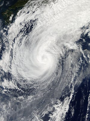 This Nov. 5, 2014 photo provided by NASA shows a picture captured by NASA's Aqua satellite of Typhoon Nuri. Weather forecasters say an explosive storm, a remnant of Typhoon Nuri, surpassing the intensity of 2012's Superstorm Sandy is heading toward the northern Pacific Ocean and expected to pass Alaska's Aleutian Islands over the weekend. (AP Photo/NASA)