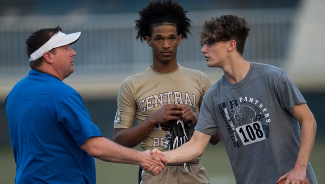 Players talk with coaches during the Southern Indiana College Day Camp at Reitz High School on Wednesday, May 9, 2018. The camp allows high school football players to get exposure with college teams.
