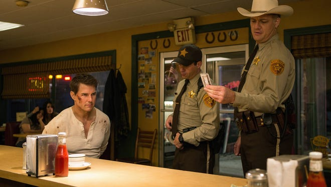 """Tom Cruise (from left), Jason Douglas and Judd Lormand star in """"Jack Reacher: Never Go Back."""""""