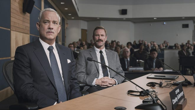 """Mustaches vs. bureaucrats: Tom Hanks  and Aaron Eckhart in """"Sully."""""""