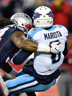 Patriots defensive tackle Ricky Jean Francois (94) sacks Titans quarterback Marcus Mariota (8) during the second half of the AFC Divisional Playoff game at Gillette Stadium Saturday, Jan. 13, 2018, in Foxborough, Mass.