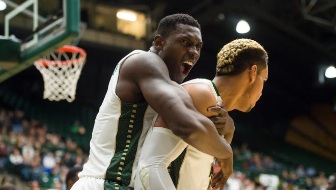 CSU forward Emmanuel Omogbo embraces teammate Gian Clavell after  he scores in a game against Loyola Marymount at Moby Arena Thursday, November 19, 2015. The Rams defeated the Lions 83-75 in the season home opener.