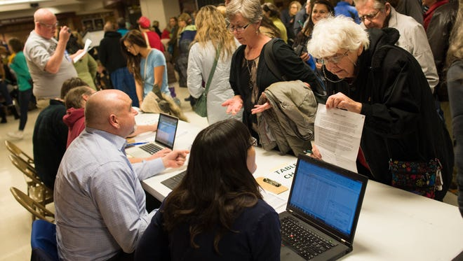 Democrats sign in to caucus at Rocky Mountain High School in Fort Collins, Colorado, on Tuesday , March 1, 2016.
