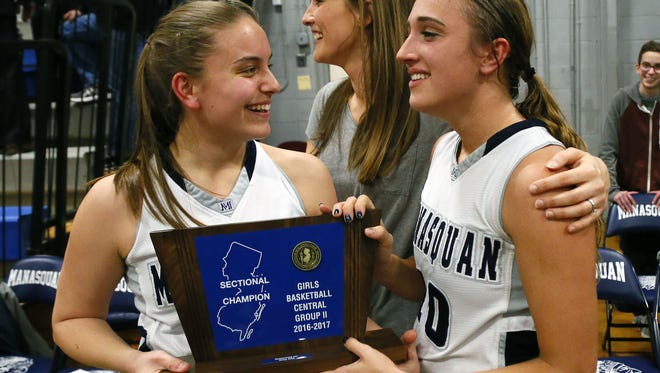 (left to right) Carly Geisler and dara Mabrey celebrate with coach Lisa Kukoda  after defeating Rumon-Fair Haven to win Girls Central Jersey Group II Championship held  at Manasquan High School. Manasquan , NJ.  Monday, March 6, 2017. Noah K. Murray-Correspondent/Asbury Park Press ASB 0307 NJSIAA Girls Hoops RDP