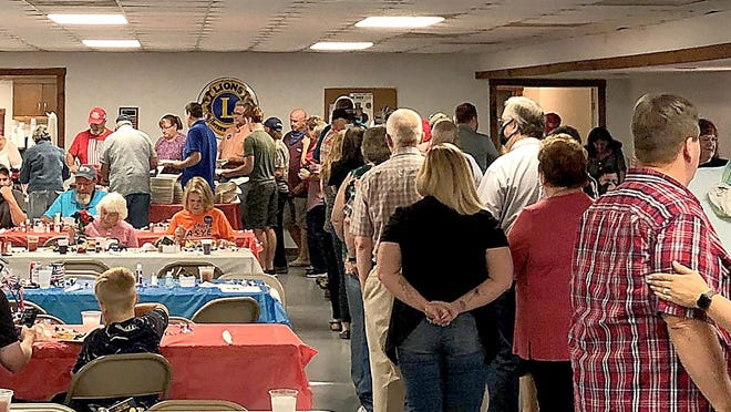 Supporters of state Rep. Chuck Basye, R-Rocheport, wait in the buffet line at a fundraiser Saturday at the Harrisburg Lions Club.