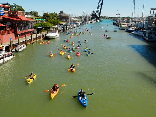 Participants head up the Black River during the 2013 Paddle and Pour event  in Port Huron.