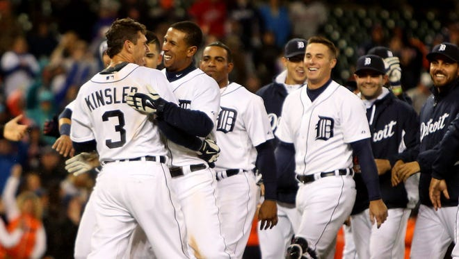 Detroit Tigers' Ian Kinsler, left, and Anthony Gose celebrate after Kinsler hit a walk-off single to score Gose in the tenth inning against the Minnesota Twins on Tuesday, May 12, 2015 at Comerica Park in Detroit.