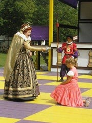 A young Abby Armstrong, right, is knighted by the queen
