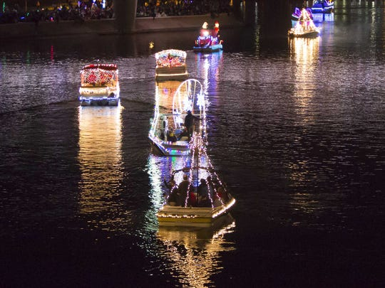 Decorated boats with various lighting designs sail