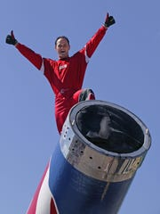 "Human Cannonball David ""the Bullet"" Smith on the barrel of his cannon chatting to the crowd and posing before his launch."
