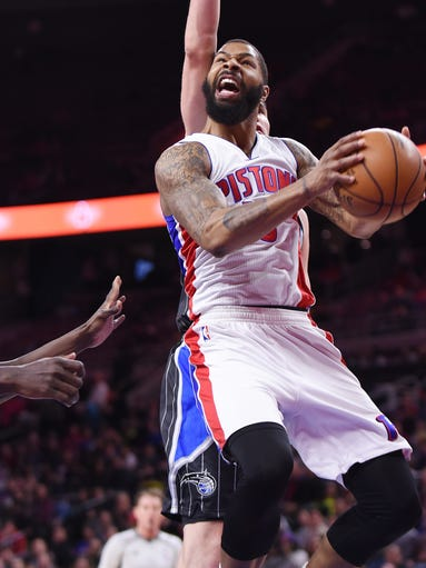 The Pistons' Marcus Morris scores over the Magic's
