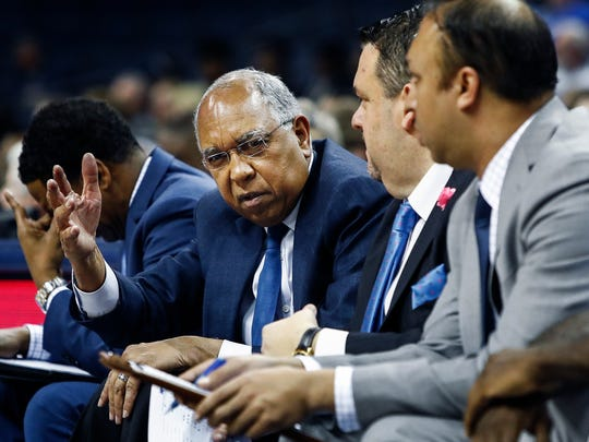 Memphis head coach Tubby Smith (left) looks on from the bench during a 75-51 loss to USF at the FedExForum in Memphis Tenn., Thursday, March 1, 2018.