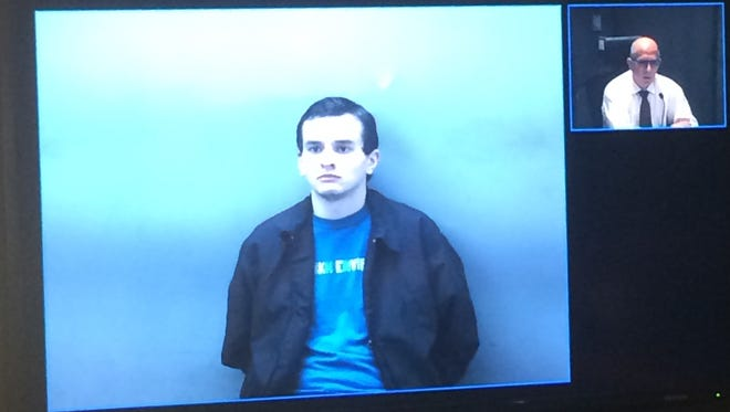 A 21-year-old Bath Township man police say followed a woman home, entered her unlocked apartment door and waited in her bedroom while she showered last week was arraigned this morning.