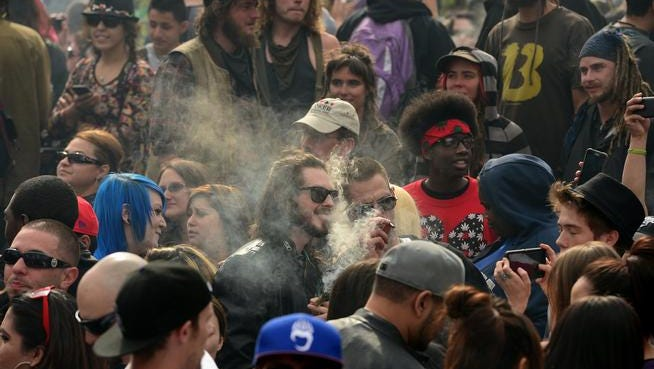 DENVER CO - APRIL 20:  Pot smokers partake in smoking marijuana at exactly 4:20 during the annual 420 celebration in Lincoln Park near the State Capitol in Denver, Colorado  on April 20, 2015.  (Photo By Helen H. Richardson/ The Denver Post)