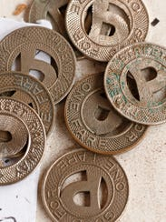 Trolley tokens that were much smaller than dimes for
