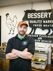 Bryan Bessery stands for a portrait in Bessery's Butcher