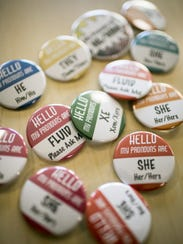 A sampling of the hundreds of gender pronoun pins distributed