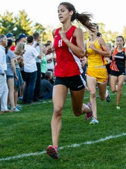 Homestead senior Allie Levin runs to a ninth-place