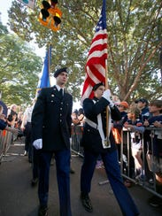 Members of the Auburn ROTC program lead the Auburn Tigers through Tiger Walk prior to a 2016 game against the Vanderbilt Commodores at Jordan Hare Stadium.