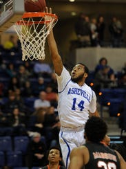UNCA's Ahmad Thomas shoots in the first half during