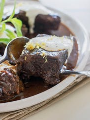 This Oct. 6, 2014 photo shows red wine braised slow