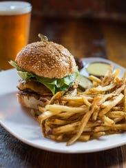 The dry-aged beef burger at Buffalo Nickel.