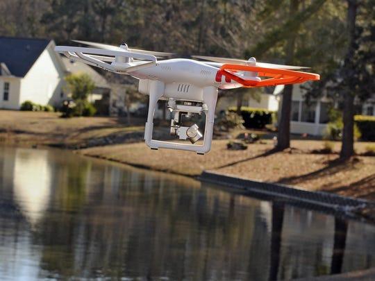 A drone looks for Jayden Morrison in Little River, S.C., on Thursday, Dec. 25, 2014.