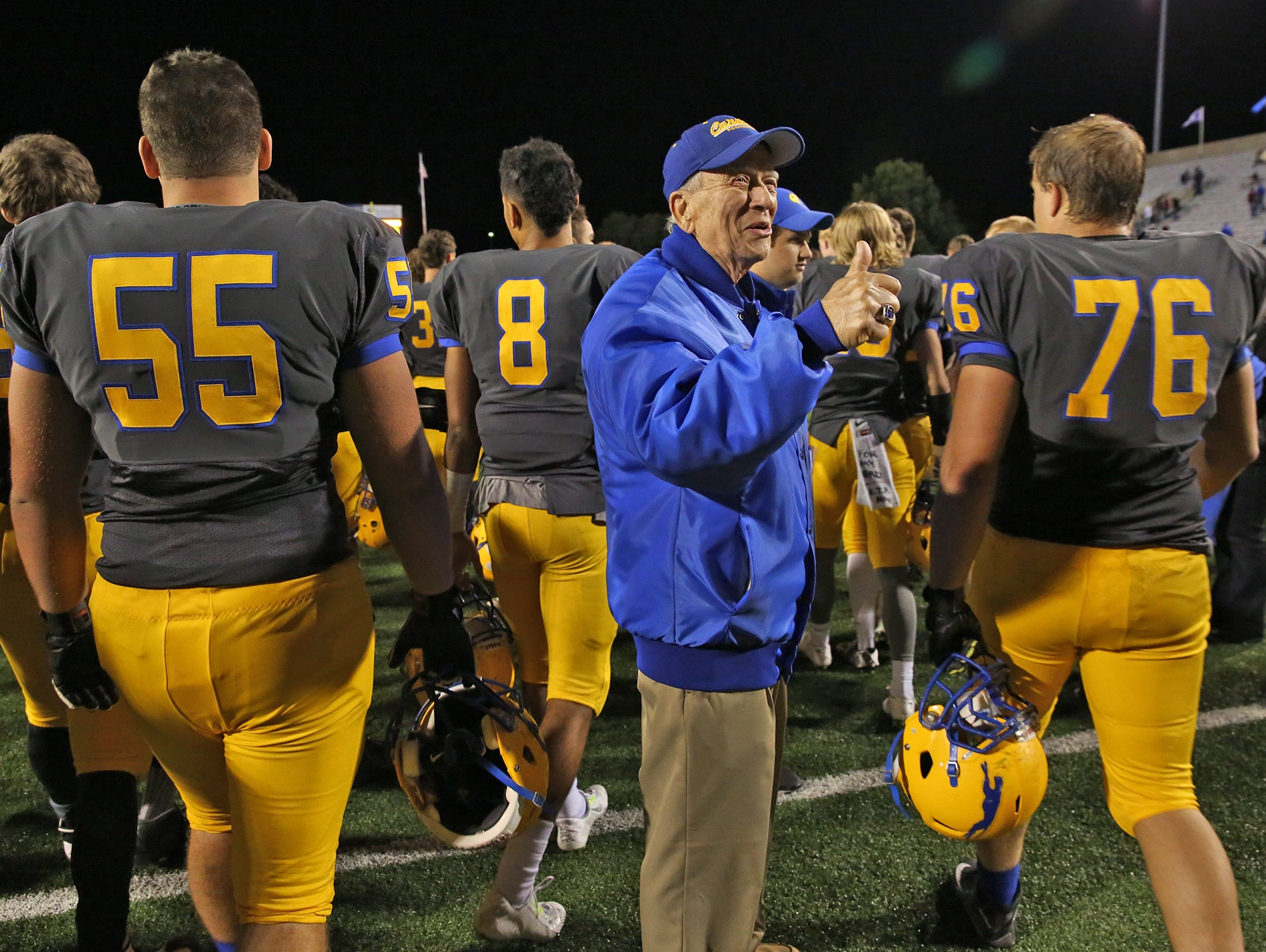 Longtime Carmel resident Jack Badger gave a thumbs up to Carmel football players after they won their game against Warren Central on Oct. 9.