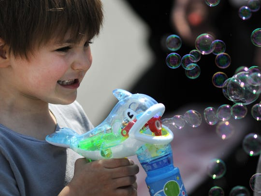 Ryan Miller, 3, of West Chester, Pa., plays with a