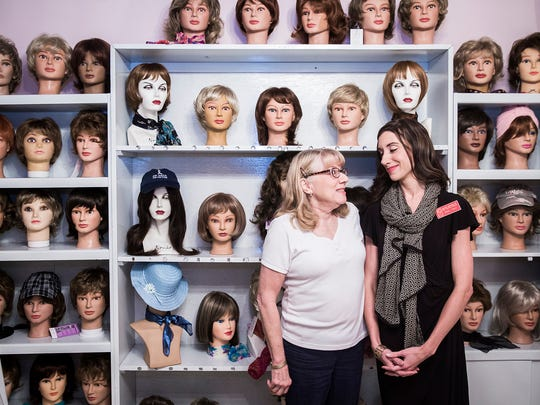 Connie Robertson and Aimee Robertson-Fant in the wig room at Little Red Door in Muncie Wednesday afternoon.