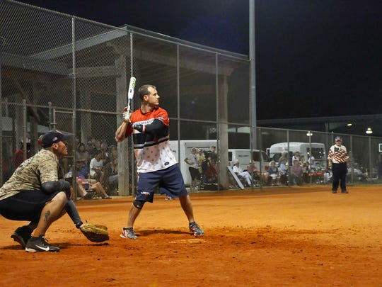 Louisville Slugger Warriors player Leonard Anderson does not let a prosthetic arm slow him down as he bats during a softball game against the Bonita Springs Fire Department at Veteran's Field Nov. 11.
