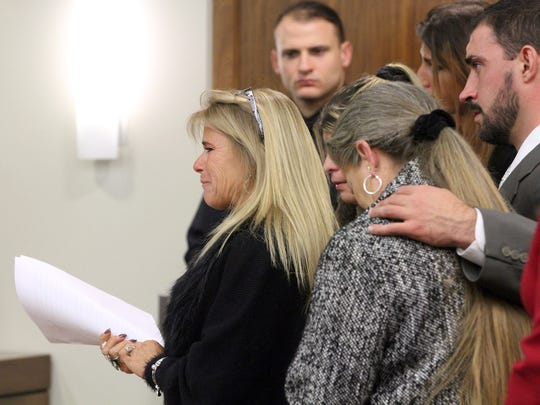 Thomas Sudano's cousin Darlene Hollingsworth is joined by other family members as they plead with Judge Ronald L. Reisner in State Superior Court in Freehold Friday, December 2, 2016, to sentence Jahmir Bouie to the maximum term for his death.  Bouie received a 55 year state prison sentence for the murder and robbery of Sudano in Asbury Park.