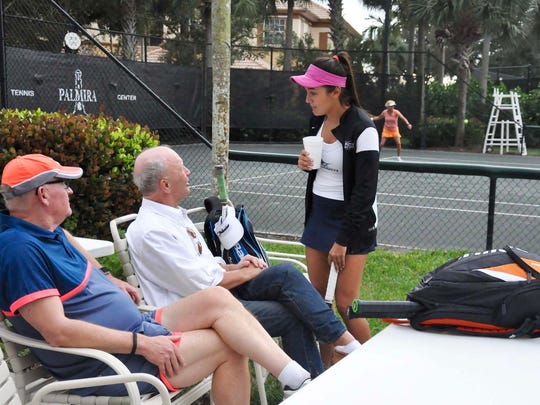 Palm Beach Atlantic University Tennis player Florencia Roncatti chats with members of Palmira Tennis Club during a charitable ProAm Jan. 14 benefitting Tennis for a Better Life Foundation.