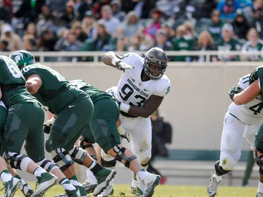 MSU DT Naquan Jones gets past the offensive line during the 2017 Green & White football game, Saturday, April 1, 2017, at Spartan Stadium in East Lansing.