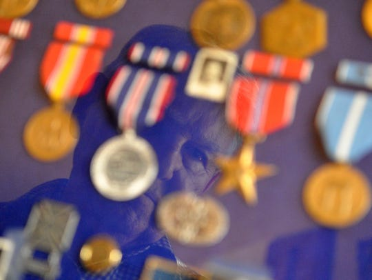 Decorated veteran Emanuel Carlo with his medals from