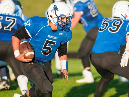 Cros-Lex quarterback Joey Johnston runs the ball during
