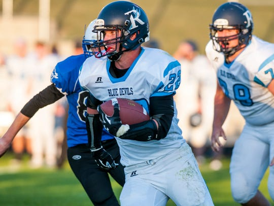 Richmond running back Austin Sinda runs the ball during