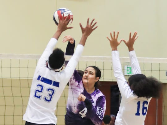 Mission Oak's (4) Samantha Arellano spikes against