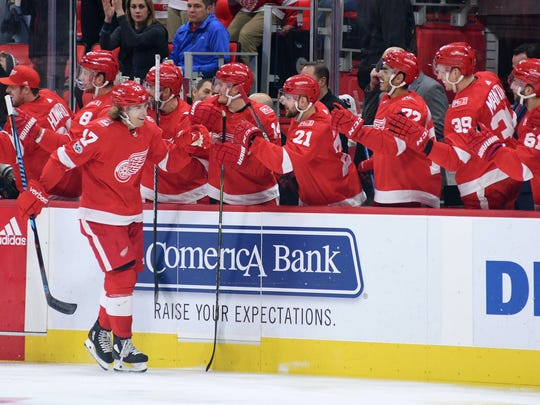 Red Wings left wing David Booth (17) celebrates his goal with teammates during the first period on Saturday, Nov. 25, 2017, at Little Caesars Arena.