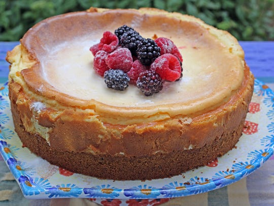 White Chocolate Cheescakeis topped with berries..