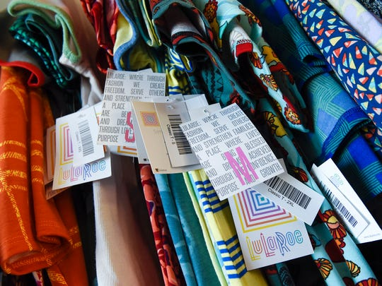 Pamela Winkelman, former LuLaRoe Clothing Company consultant, has a few outfits left she has not been able to sell or that are defective at her home.
