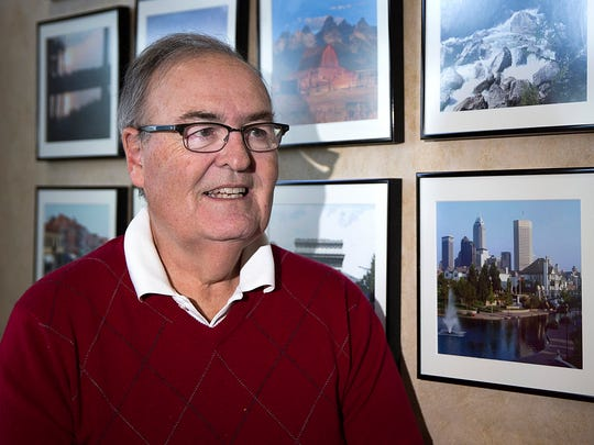 Rich Bell is a retired lawyer who has filed or threatened hundreds of copyright infringement lawsuits over a photo he shot of the Indianapolis skyline in 2000, pictured at right. Bell poses for a portrait against a wall of pictures he has taken, at his home in McCordsville, Ind., Thursday, April 26, 2018.