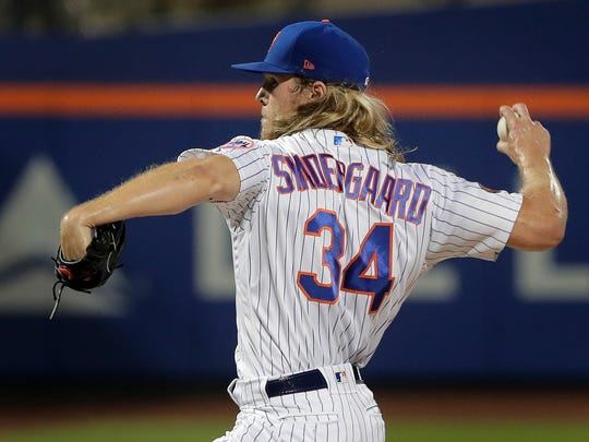 New York Mets pitcher Noah Syndergaard (34) delivers against the Toronto Blue Jays during the first inning of a baseball game, Tuesday, May 15, 2018, in New York.